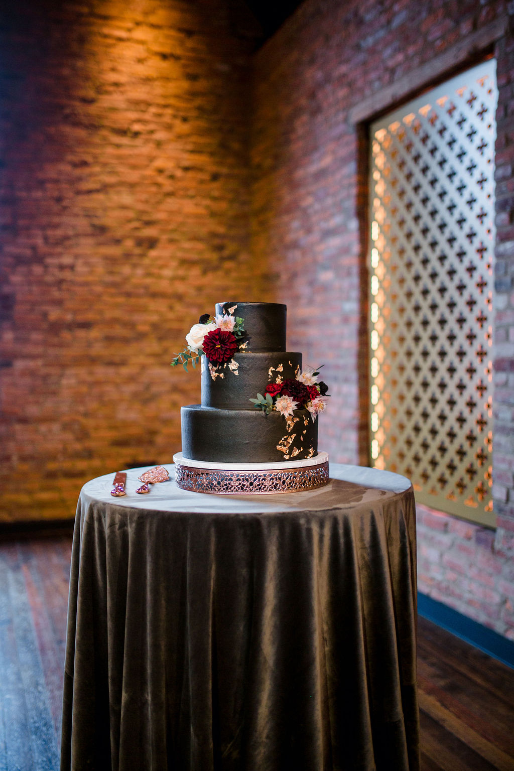 Black wedding cake with red flowers | Nashville Bride Guide