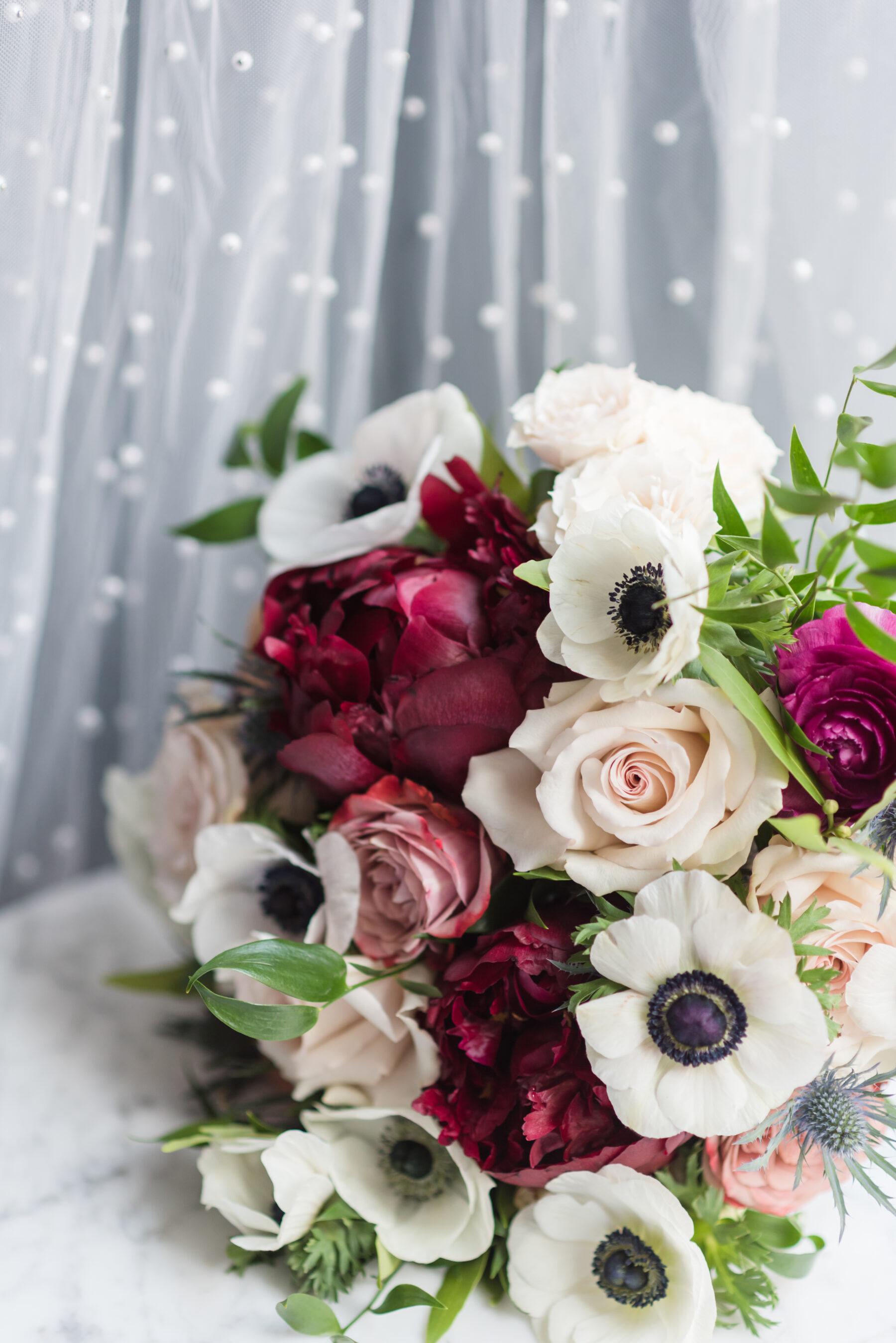 Burgundy, pink, and white wedding bouquet