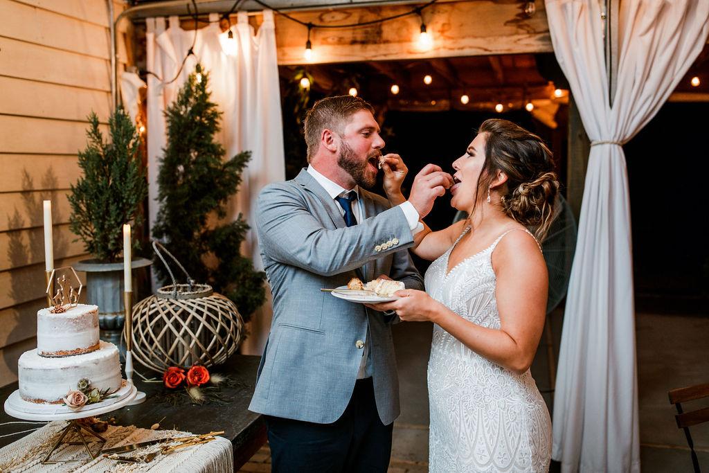 Bride and groom cutting wedding cake | Nashville Bride Guide