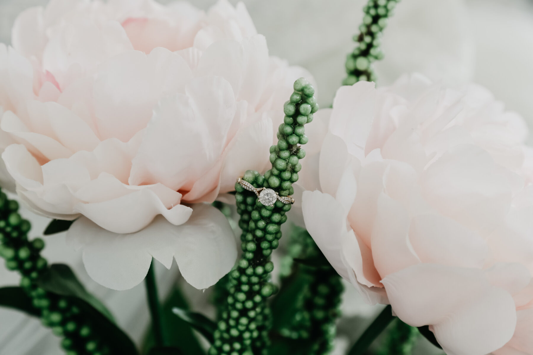 Engagement ring in greenery | Nashville Bride Guide