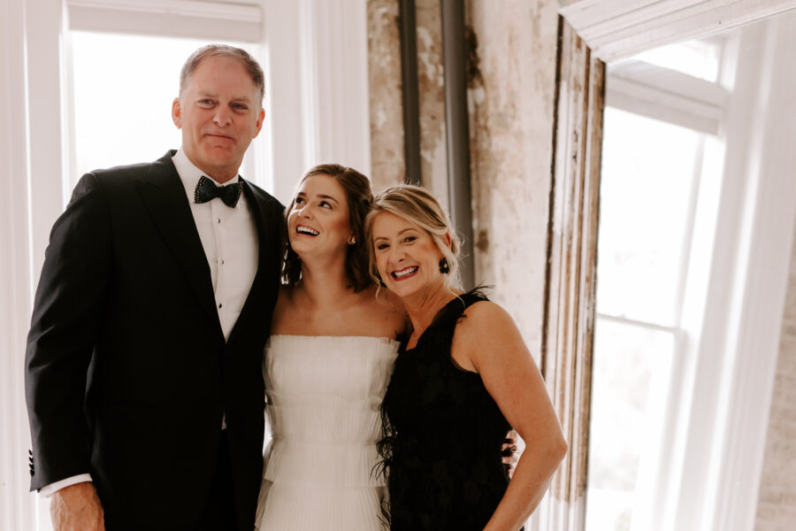 Bride taking a photo with her parents   Nashville Bride Guide