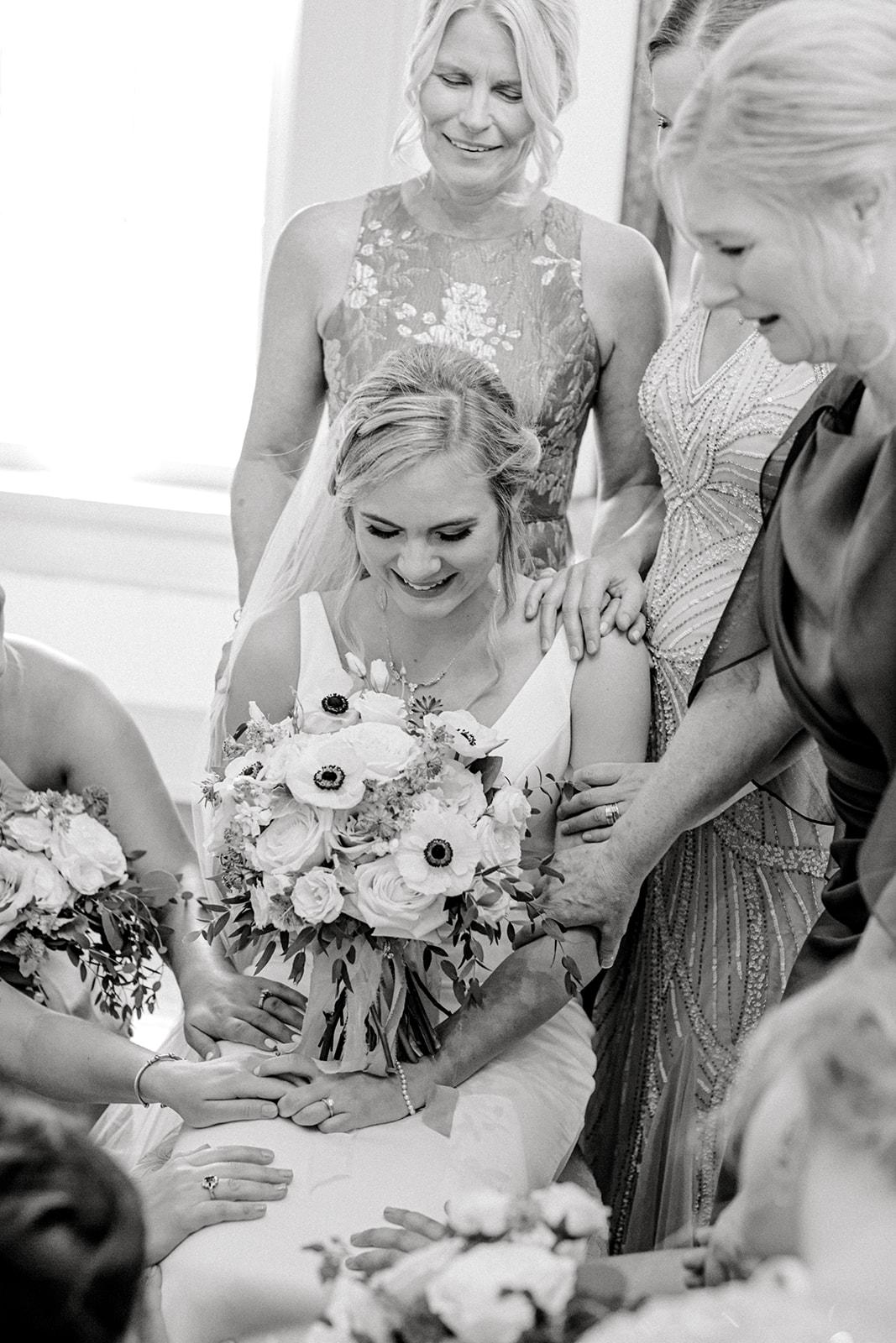 Bridesmaids praying with bride | Nashville Bride Guide