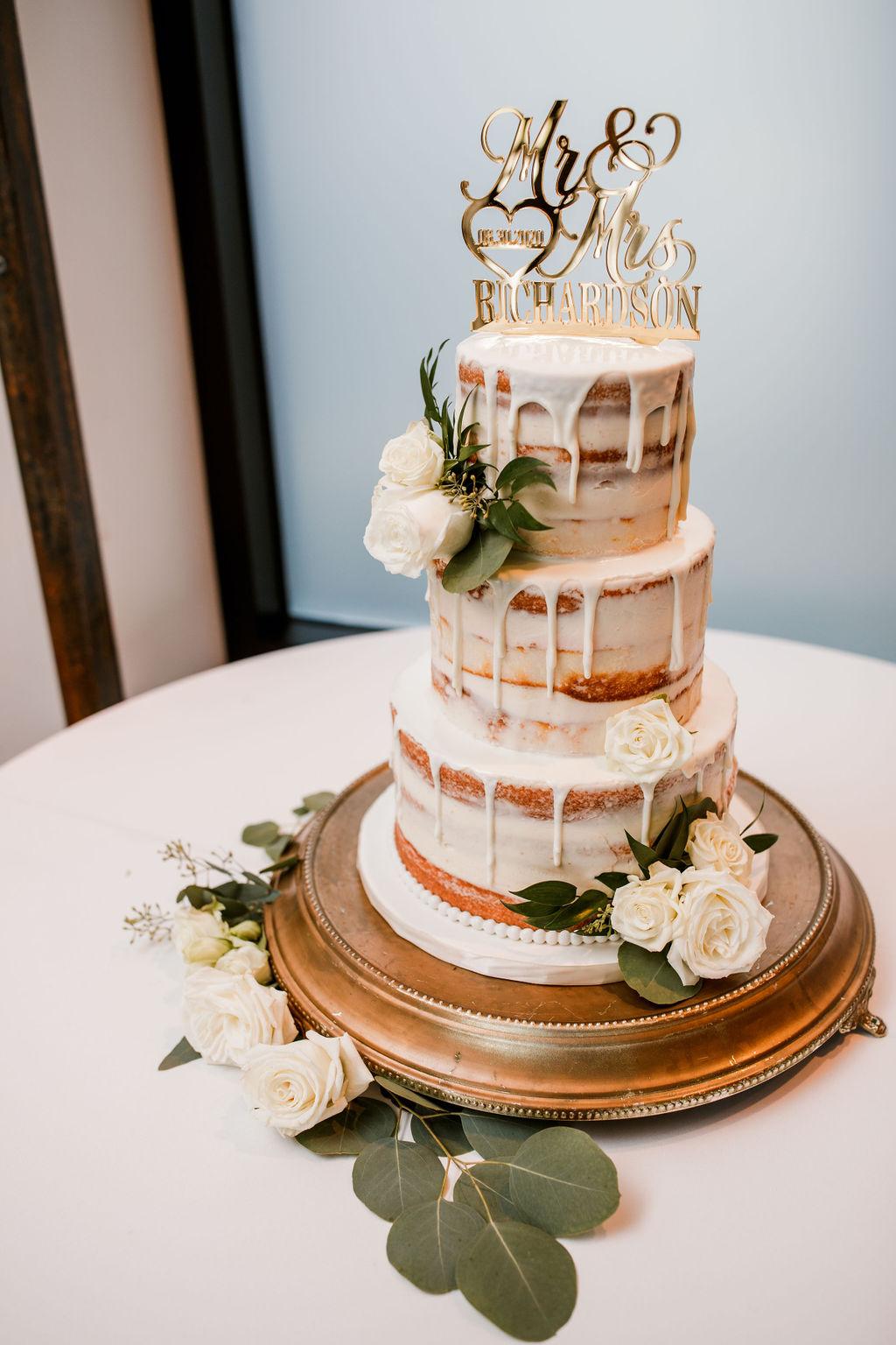 Neutral semi naked drip wedding cake | Nashville Bride Guide