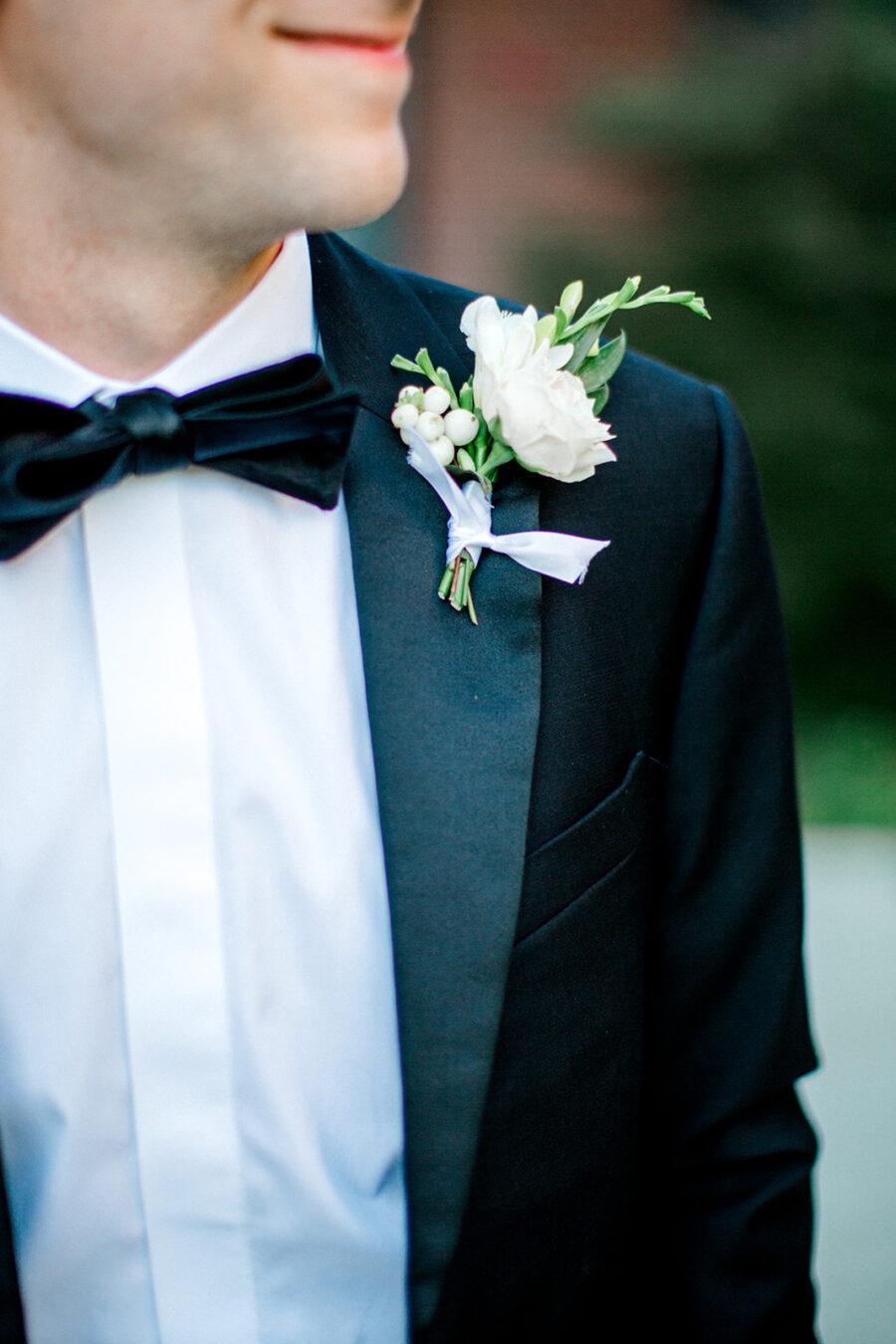 White and greenery wedding boutonniere