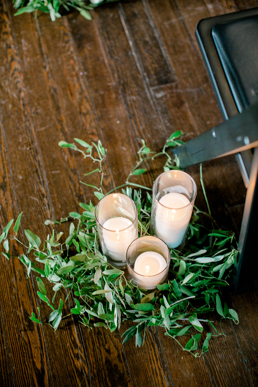 Candles and greenery wedding ceremony decor