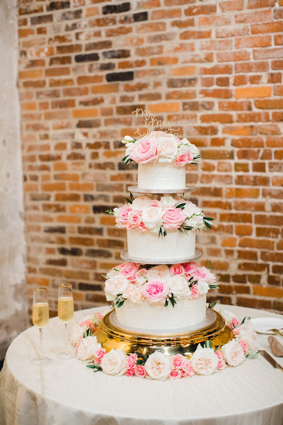 Pink and white floral wedding cake design