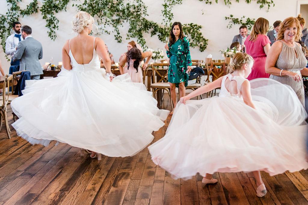 Bride and flower girl twirling dresses | Nashville Bride Guide