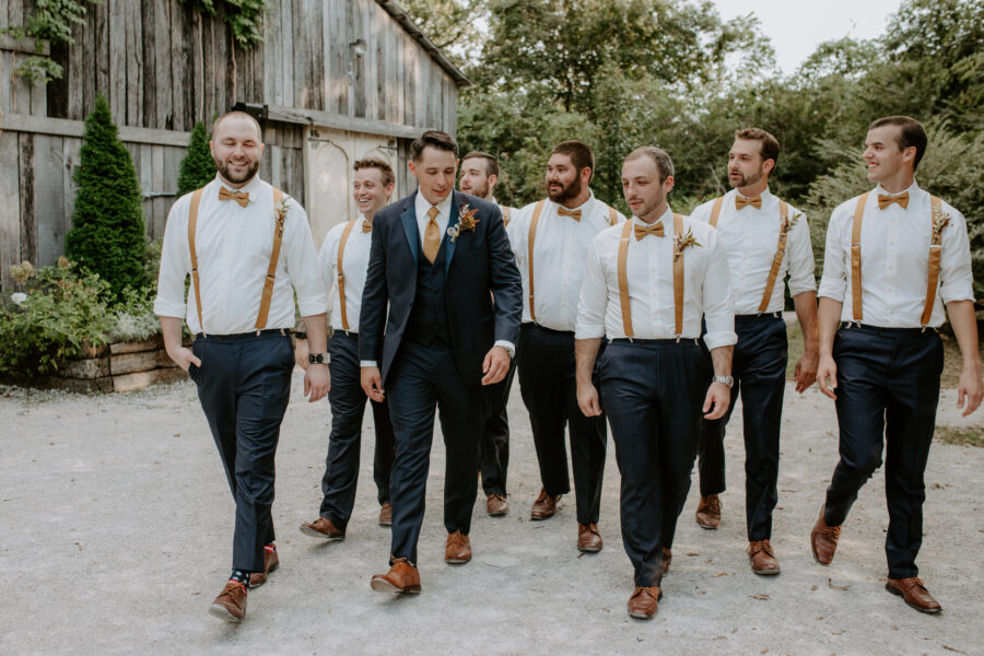 Groom and groomsmen attire from Tuxedo Avenue