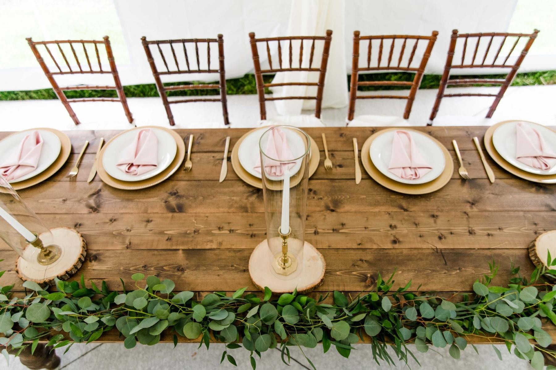 Rustic wedding table with greenery
