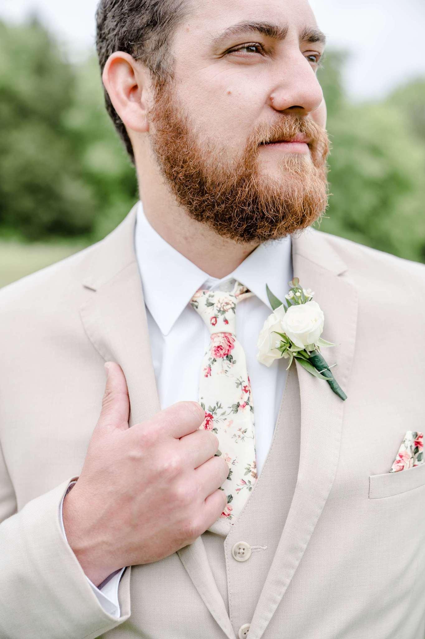 Beige wedding tuxedo with floral wedding tie