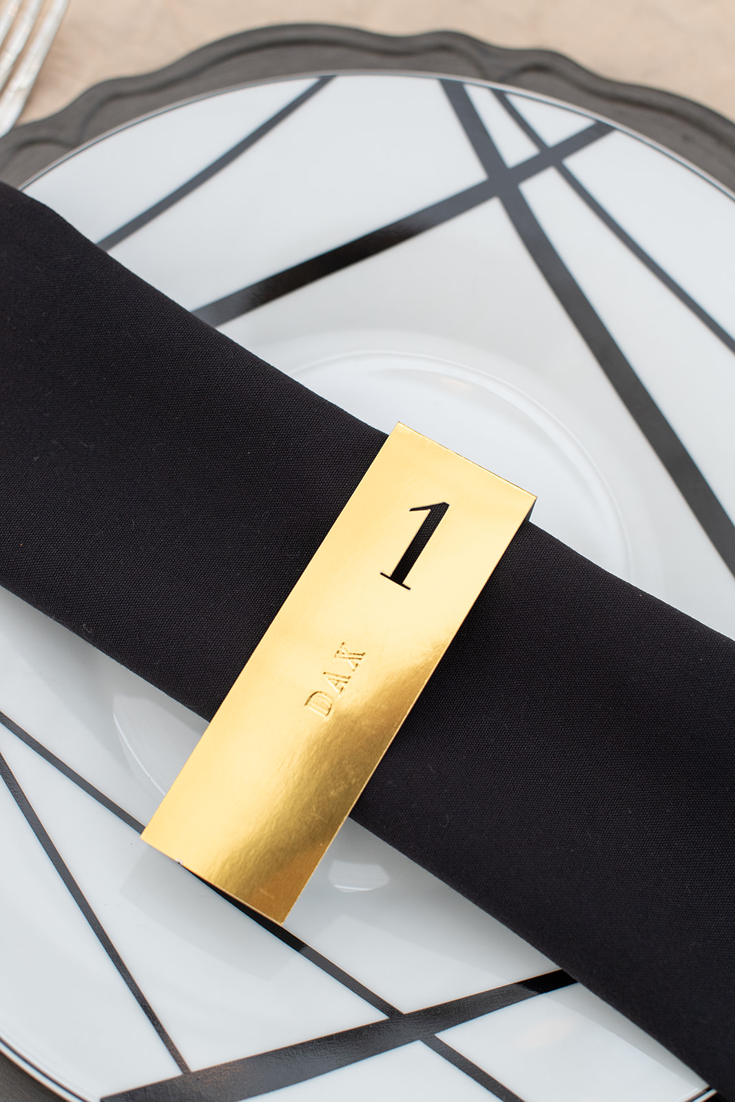 Black and gold wedding escort card design