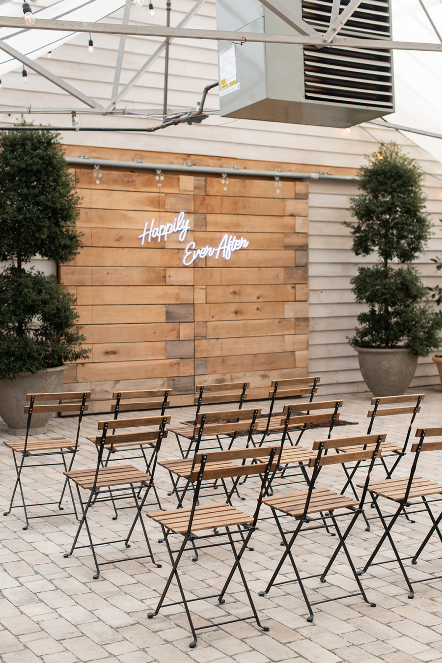 Bistro wedding chairs and neon wedding ceremony sign