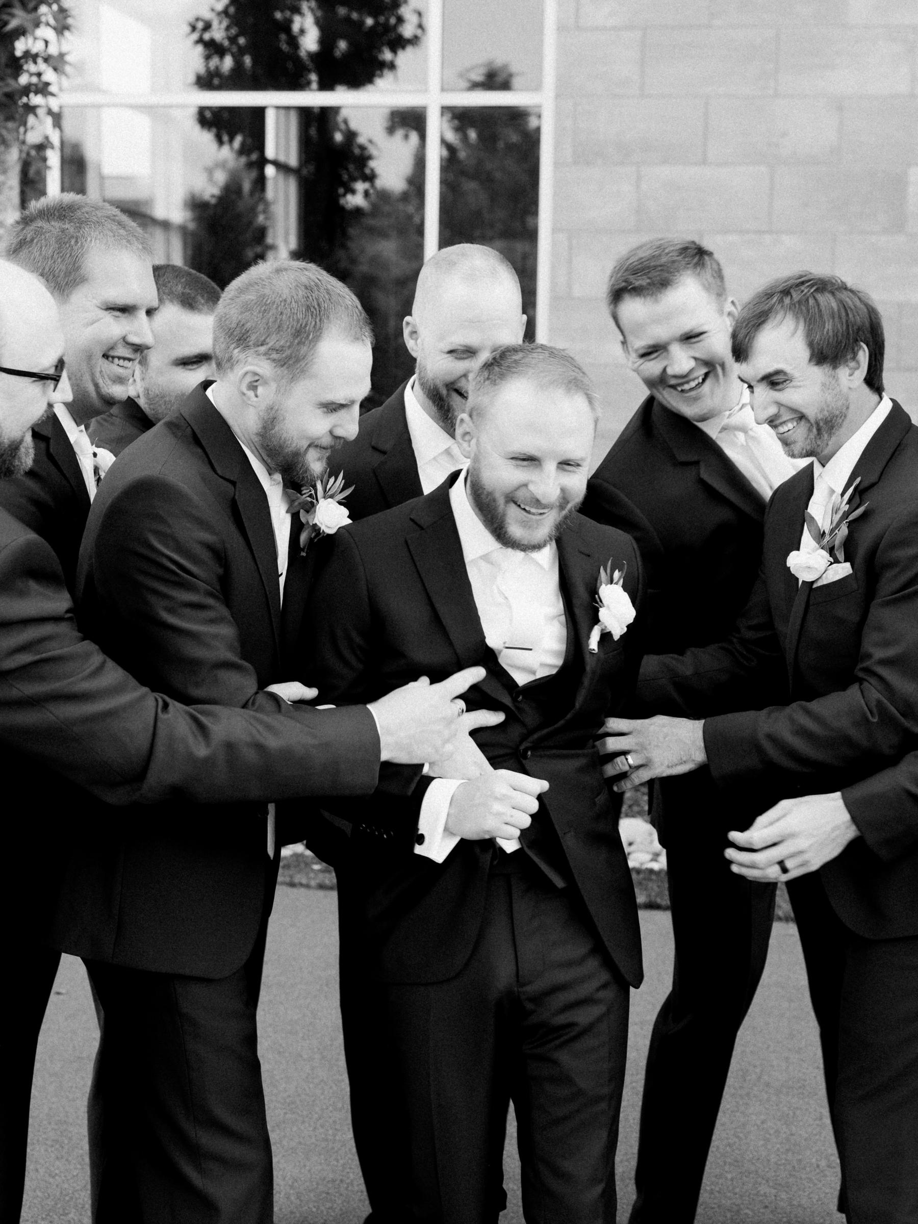 Black and white groomsman photo