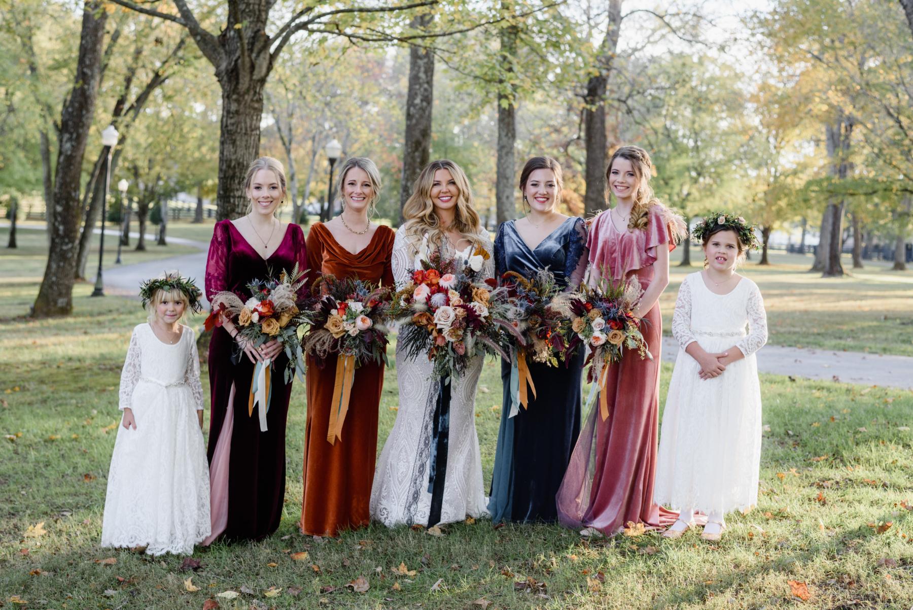 Mismatched velvet bridesmaids dresses