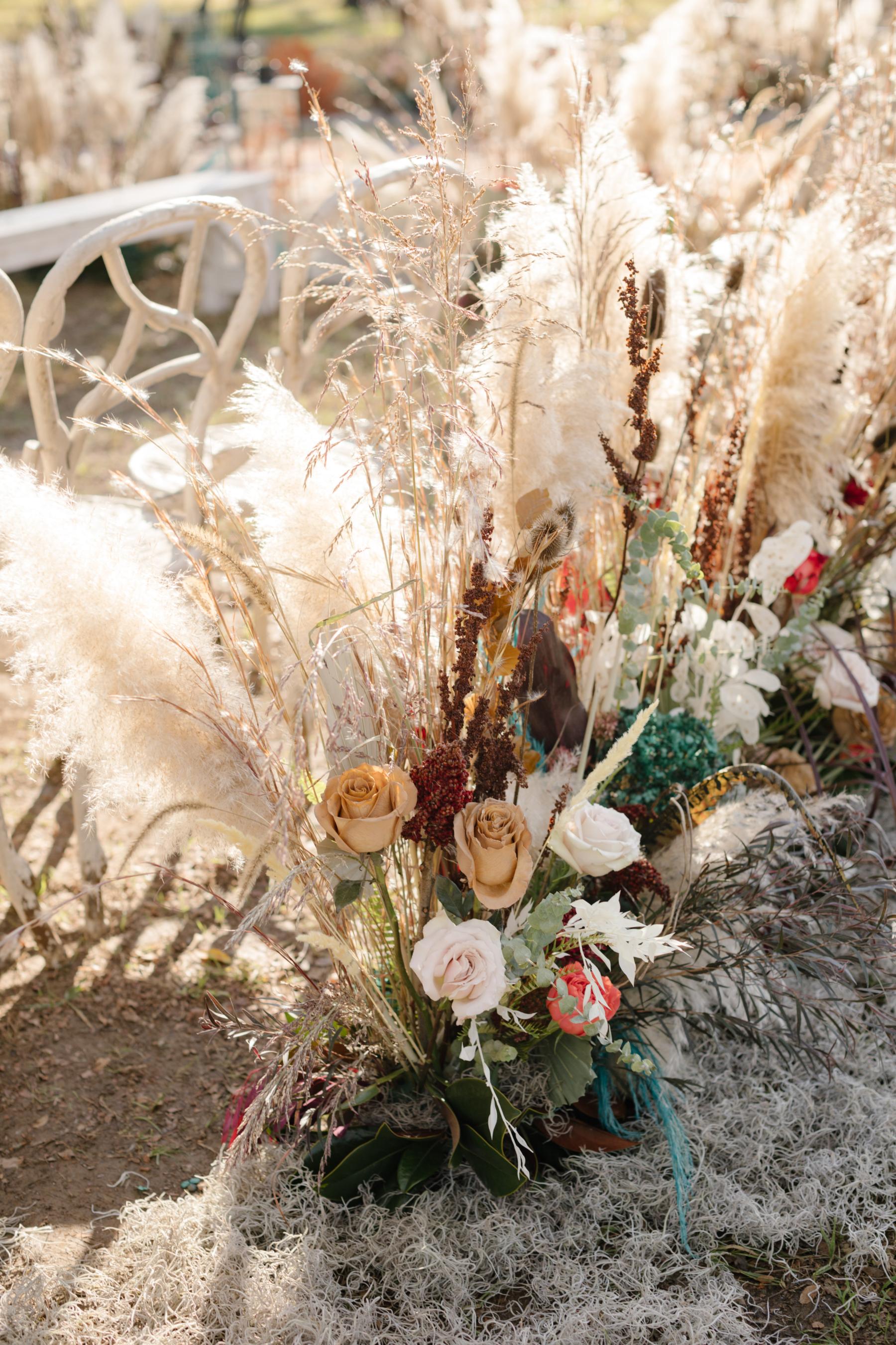 T. Villager wedding ceremony flowers