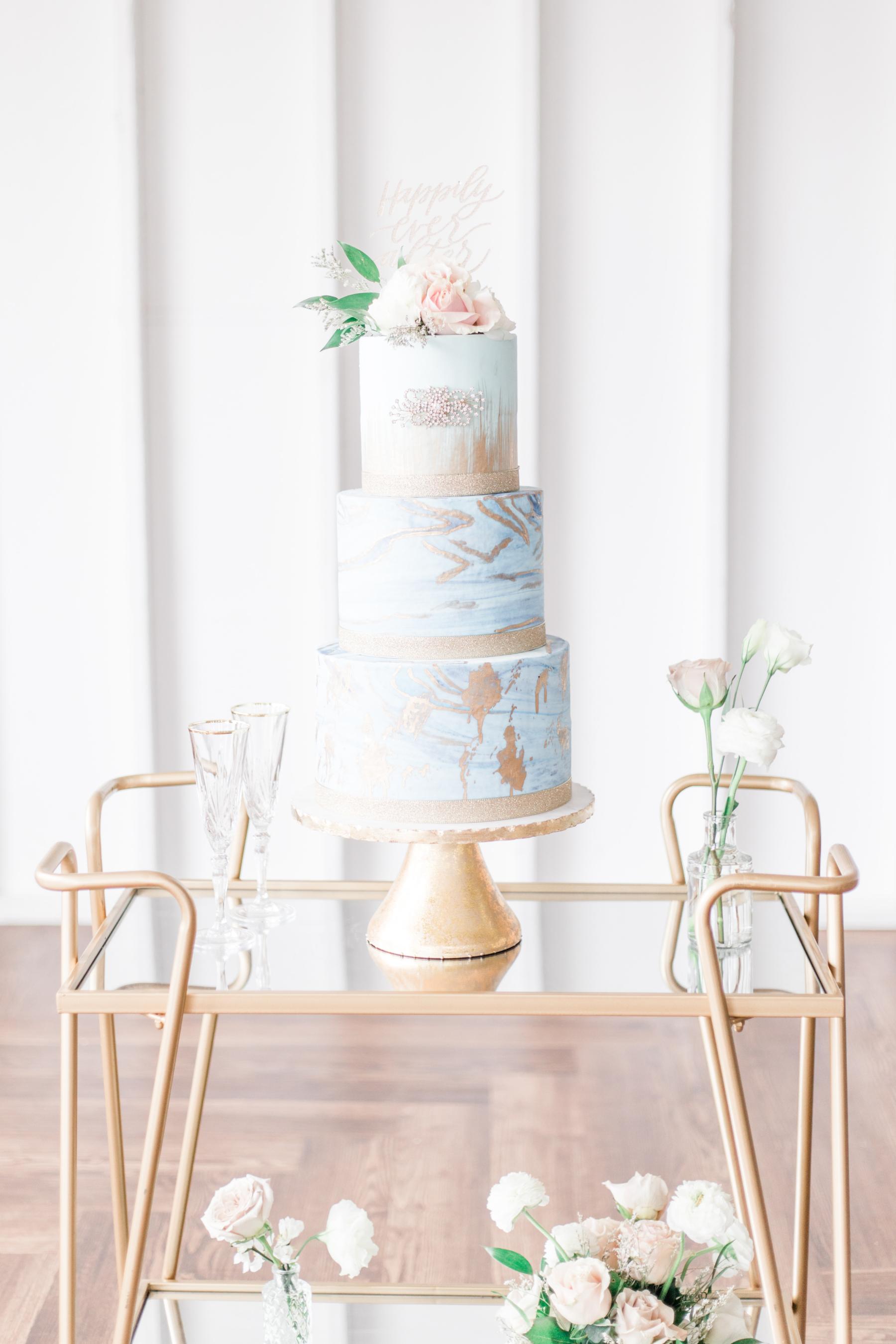Blue and gold fine art wedding cake