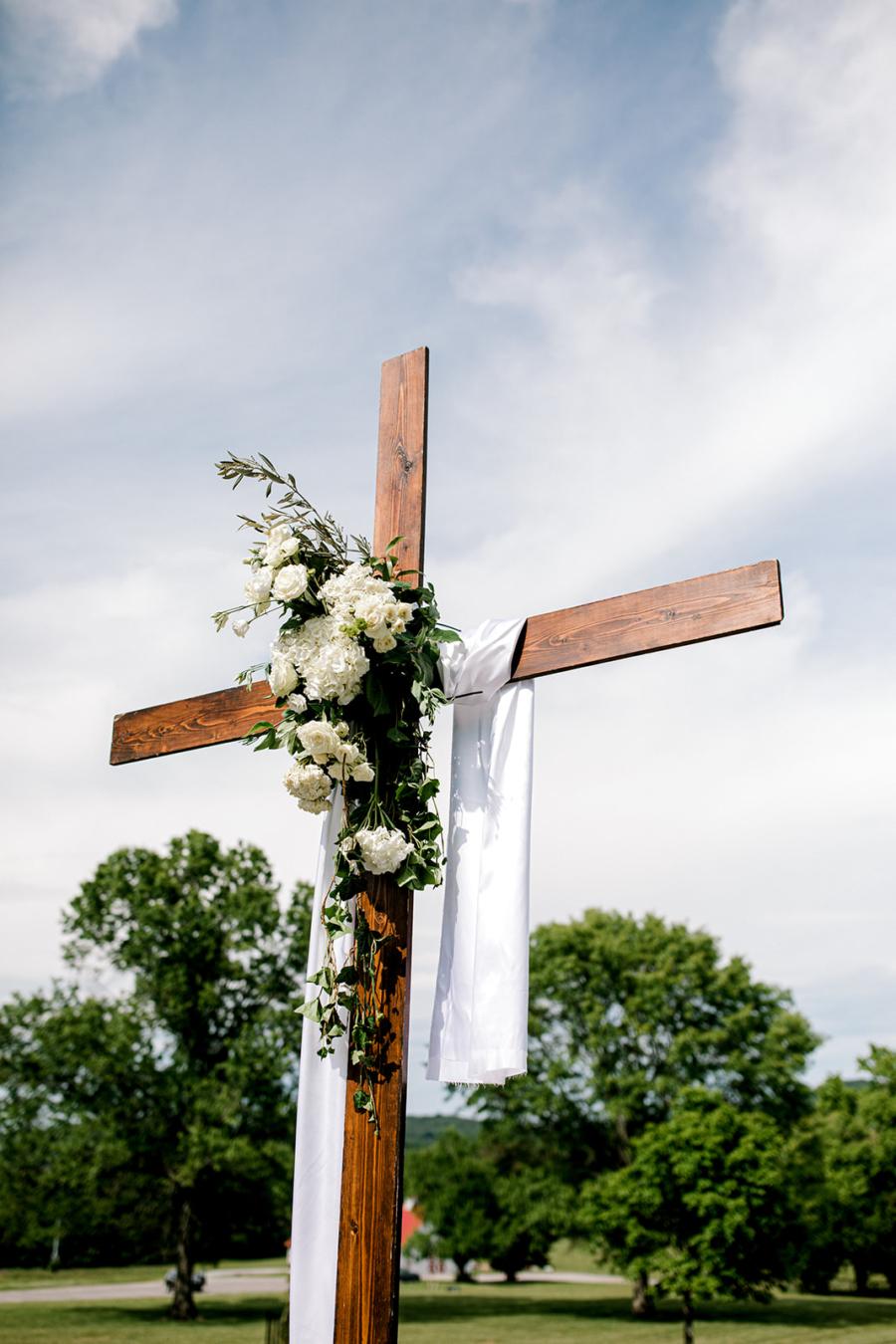 Outdoor wedding ceremony wooden cross