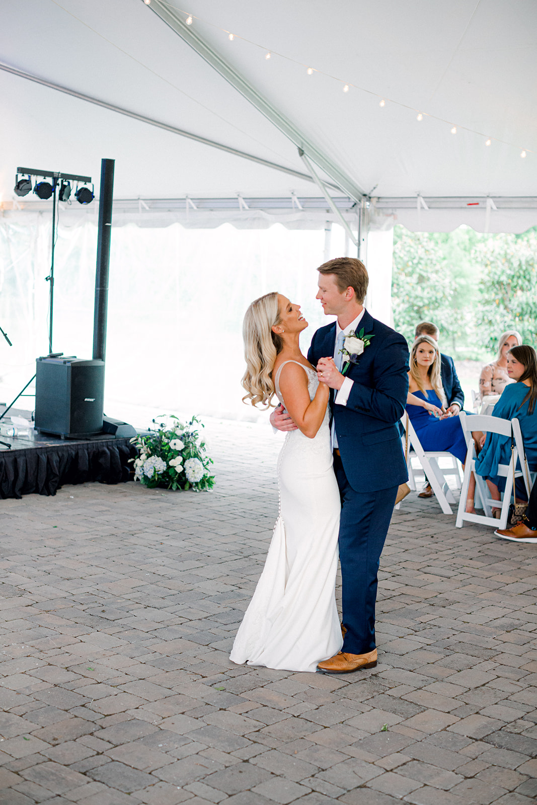 Bride and groom first dance at semi outdoor wedding reception