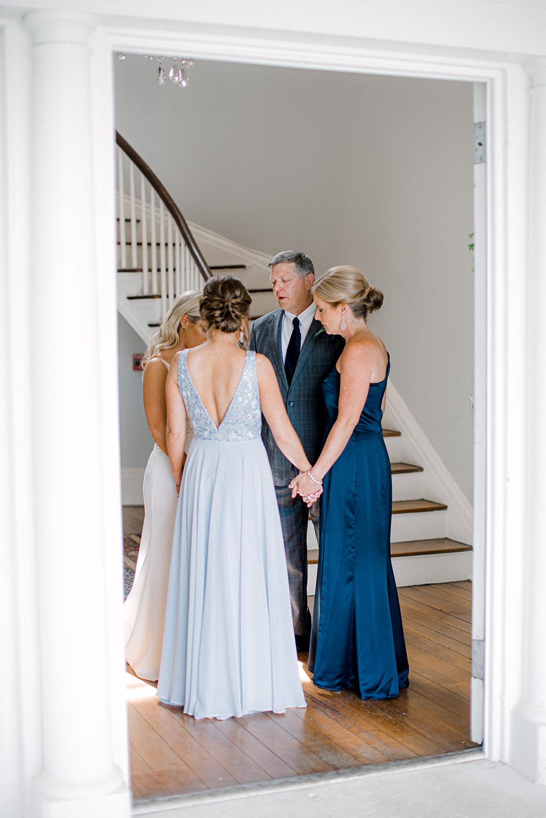 Family prayer before wedding ceremony