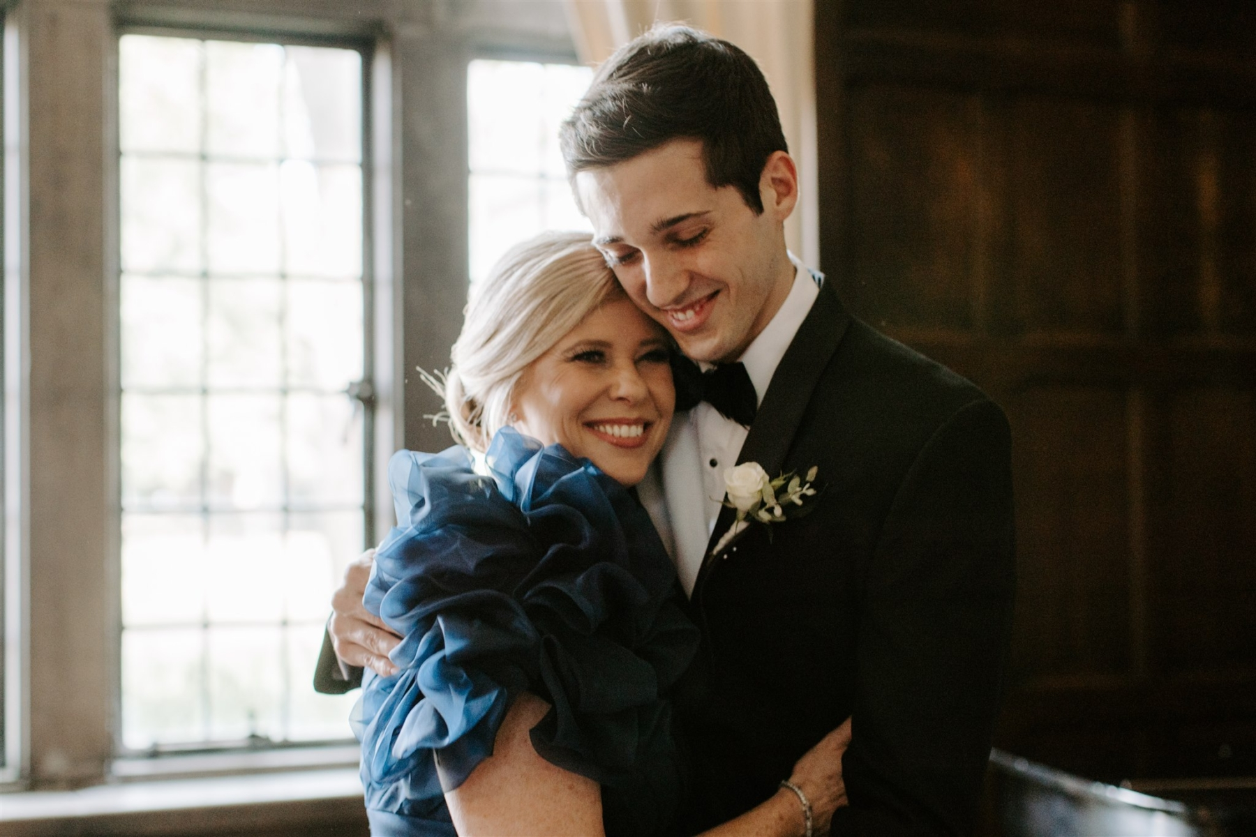 Mother of the groom hugging son