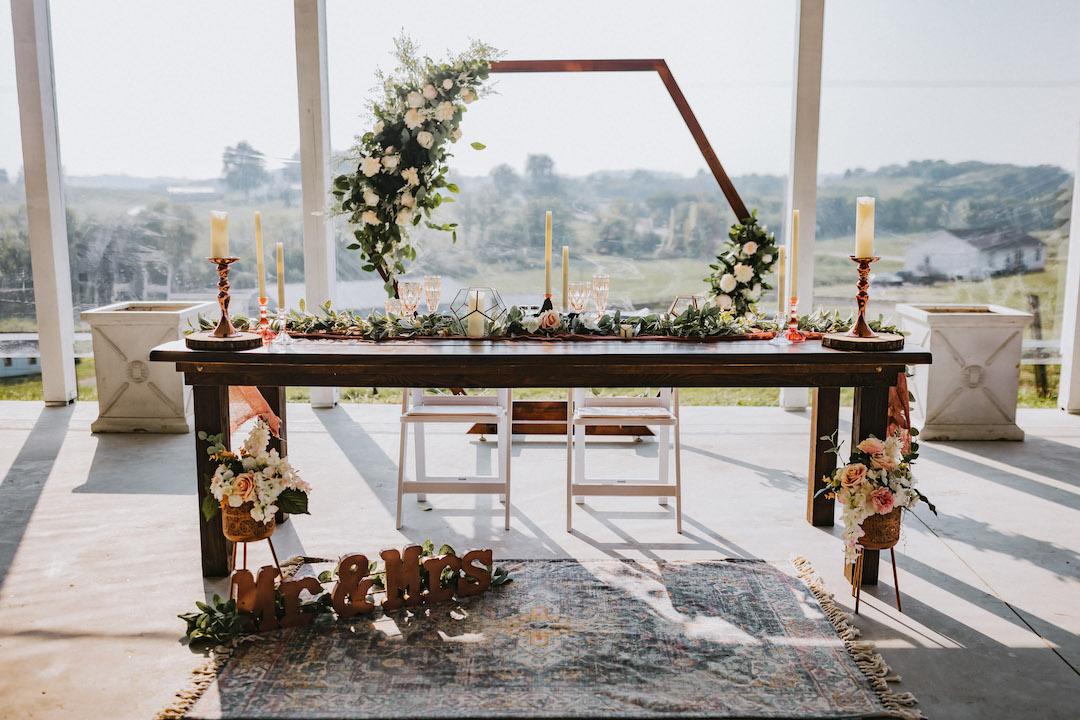 Rustic sweetheart table with geometric backdrop