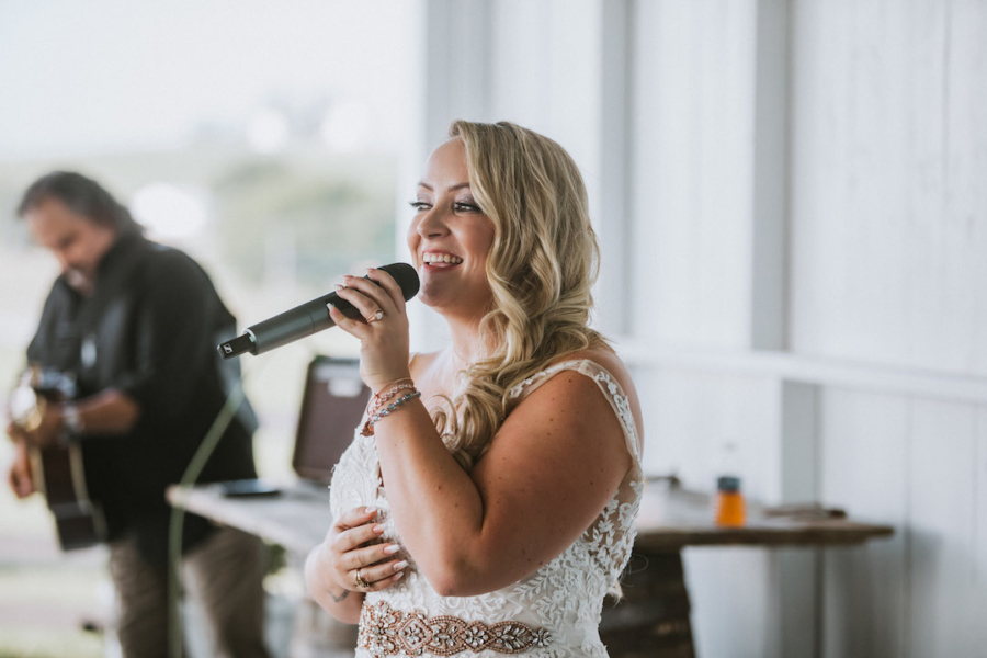 Bride performing song for groom