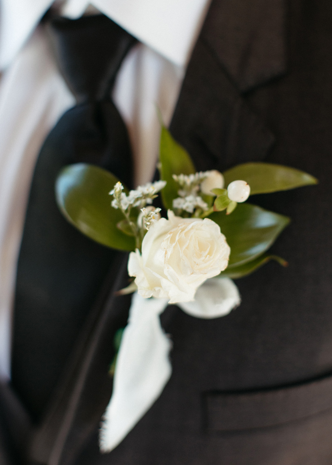 White flower and greenery wedding boutonniere