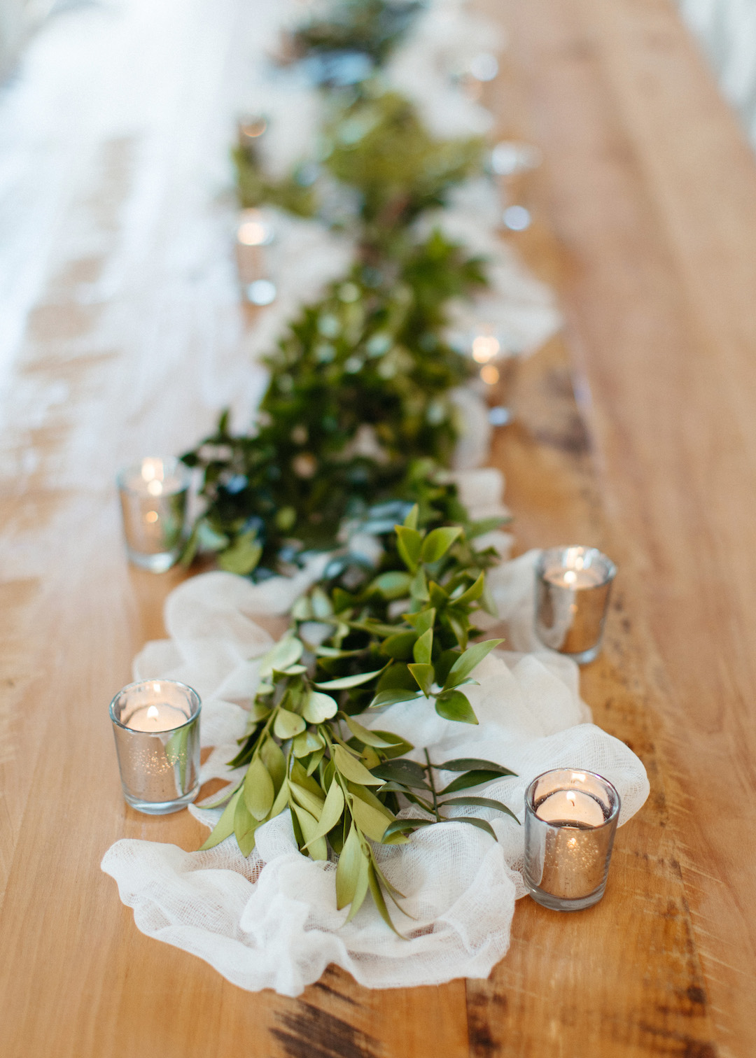 Greenery and candles wedding centerpieces